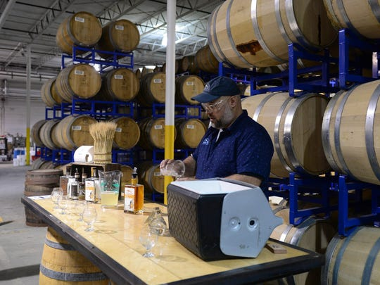 Lars Ryan, Off-Centered Experience Ambassador, teaches about rum, along with sampling during the new distillery tour at the Dogfish Head Milton Brewery and Distillery on Wednesday, May 16, 2018.