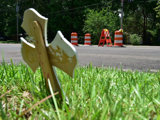 A cross was placed across from the location of the Ridgewood Road accident that killed Jackson Academy senior Frances Fortner on May 17, 2018.