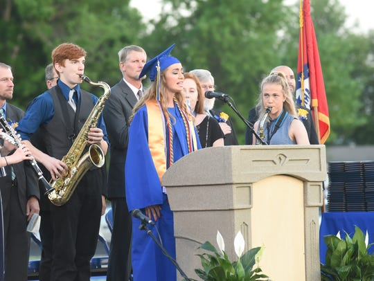 A member of the Class of 2018 sings during the 2018 Mountain Home High School graduation ceremony.