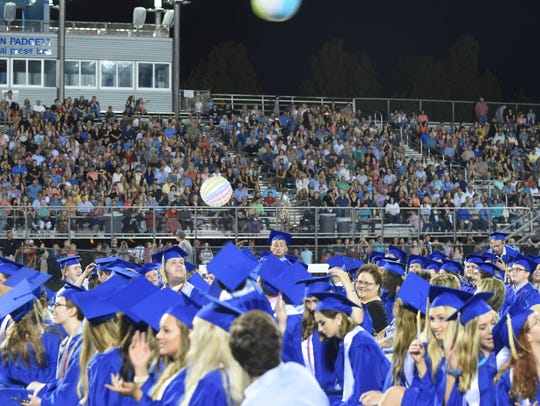 Members of the Class of 2018 play with beach balls in what has become an annual tradition.