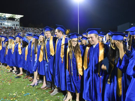 Graduating seniors from Mountain Home High School's Class of 2018 lock arms and sing the alma mater during last year's graduation ceremonies. Five area high schools will hold their 2019 graduation ceremonies over the next 10 days.
