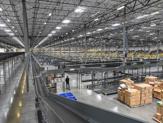 Packages move through the Zulily fulfillment center