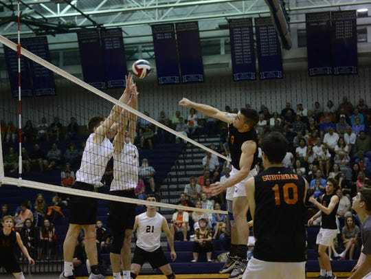 York Suburban's Peter Groncki hits over a pair of Northeastern blockers in Game 2 of Northeastern's 3-0 victory Wednesday, May 23, 2018.