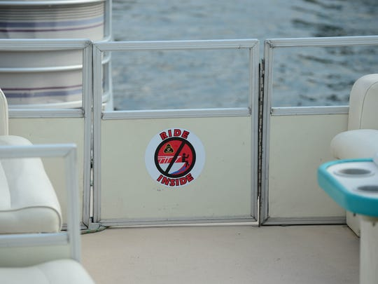 """A """"Ride Inside"""" safety sticker can be seen on a pontoon"""