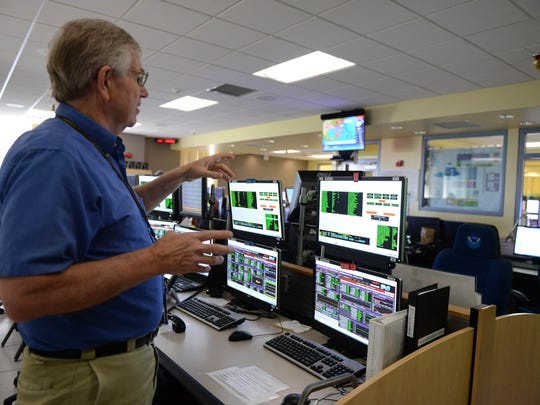 Albert McMath Jr., NOAA Operations Branch Chief, shows where the data is received from the satellites that are currently in space on Thursday, May 24, 2018 in Wallops, Va.