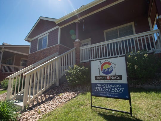 A sign gives information on a home for sale on 16th Street Road in Greeley on Saturday, May 26, 2018.