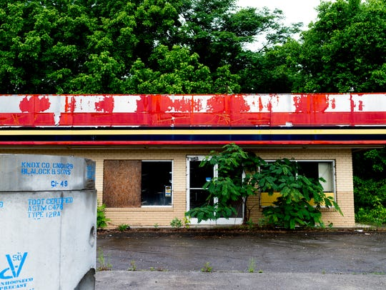A shuttered gas station along Alcoa Highway falls into