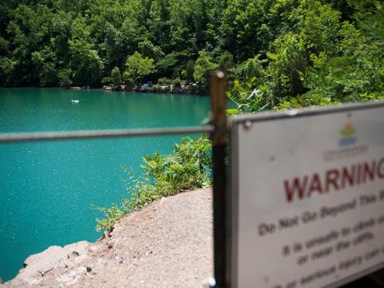 A sign warns people not to jump off the cliffs at Fort Dickerson Quarry.