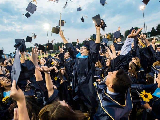 Littlestown Senior High School graduates toss their