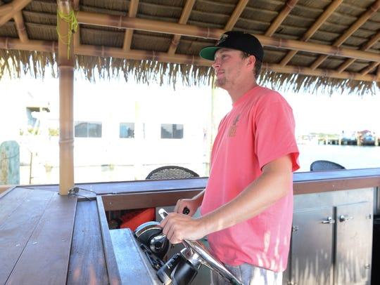 Justin Mears prepares to drive the Tipsy Tikis bar,