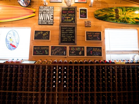 A variety of wines produced on premises are available in the tasting room at Summer Crush Vineyard & Winery, as seen June 3, 2018, at 4200 Johnston Road in St. Lucie County. Owner Gary Roberts, who was concerned about his nursery business at the time, expanded into winemaking in 2012, utilizing native muscadine grapes in his winemaking.