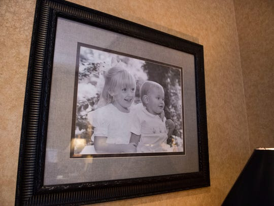 A photo of Robert Pryor and his late wife Cheryl's children, taken around the time of Cheryl's passing, as seen in his office Monday, June 4, 2018. Pryor's executive assistant Denise Dixon had the photo framed and gave it to Pryor.