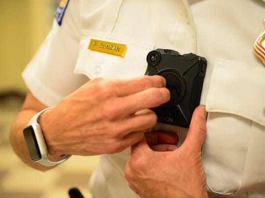 Salisbury Police Chief Barbara Duncan shows how the officers turn on one of the Axon body camera's worn by the uniform police officers.