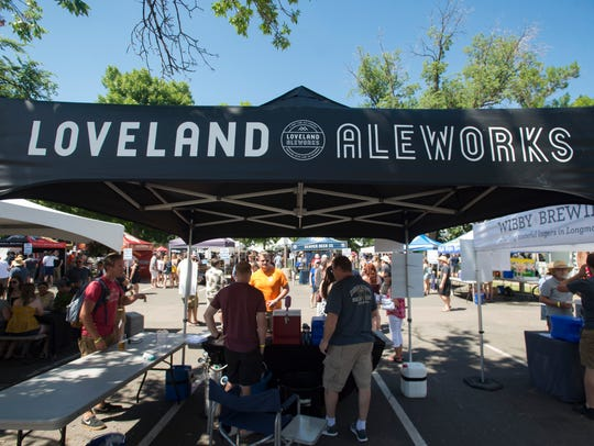 Loveland Aleworks pours beers for attendees at the