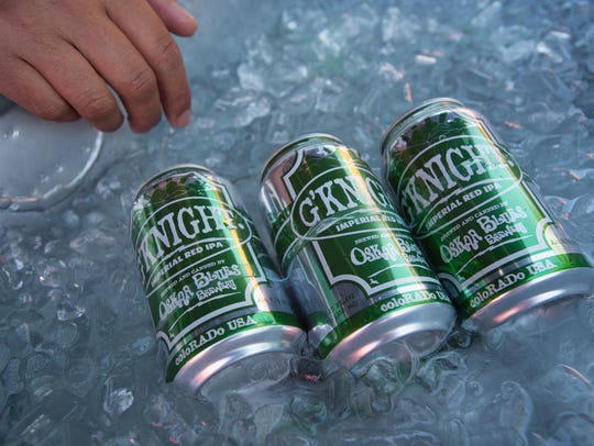 Beers from Oskar Blues Brewery sit on ice at the Colorado