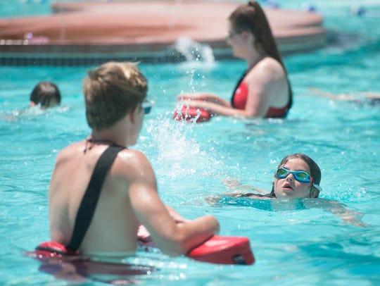 Kiah Tippmann, 6, kicks and paddles her way through