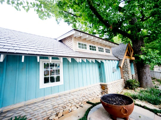 """Jimmy's Hideaway"" is a small private cottage that can be booked is situated beneath some trees on the resort property during an exclusive sneak peek inside the all-new Margaritaville Resort in Gatlinburg, Tennessee on Wednesday, June 27, 2018."
