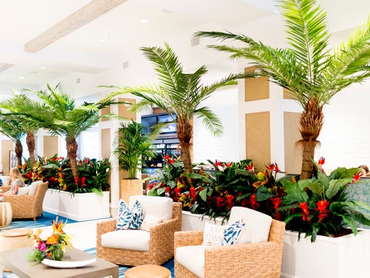 Palm trees adorn the lobby during an exclusive sneak