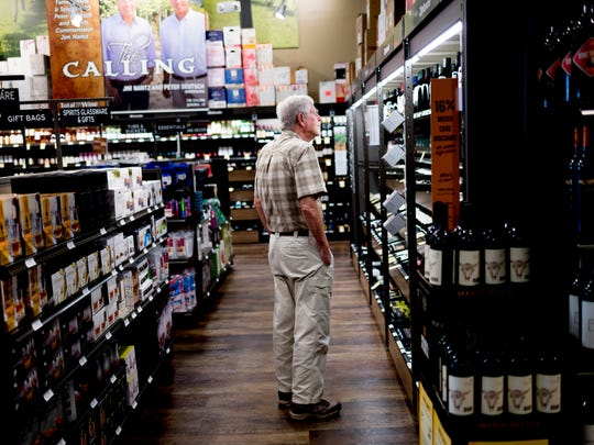 A shopper takes a look at a shelf of wine at Total Wine in Turkey Creek in Farragut, Tennessee on Tuesday, June 26, 2018.