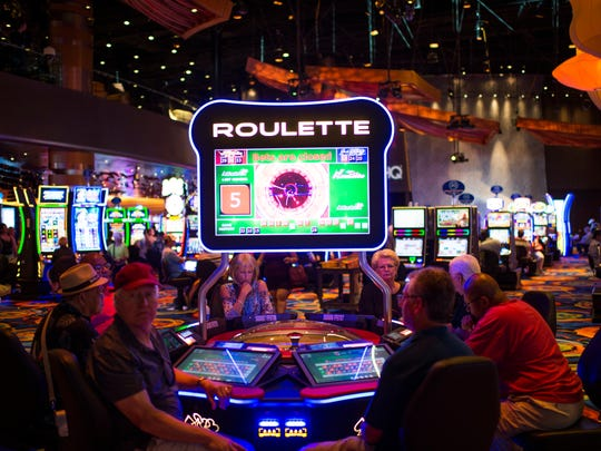 Guests play roulette inside the Ocean Resort Casino