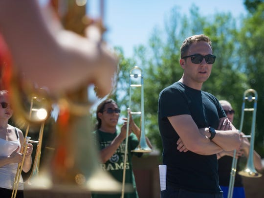Nicholas Peterson oversees the Loveland High School marching band during summer band practice in Loveland on Thursday, June 28, 2018. Peterson works as a counselor at Fossil Ridge High School in Fort Collins during the school year.