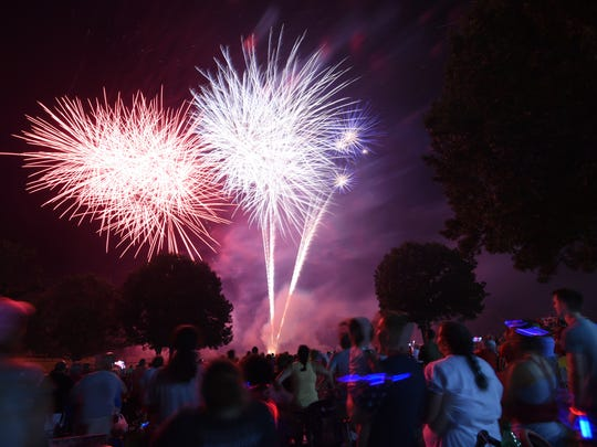 Fireworks explode over the campus of Arkansas State University-Mountain Home during the closing moments of 19th annual Red, White and Blue fireworks show last year.
