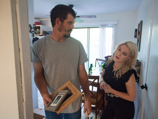 Cody and Sierra Briggs work to make their new house