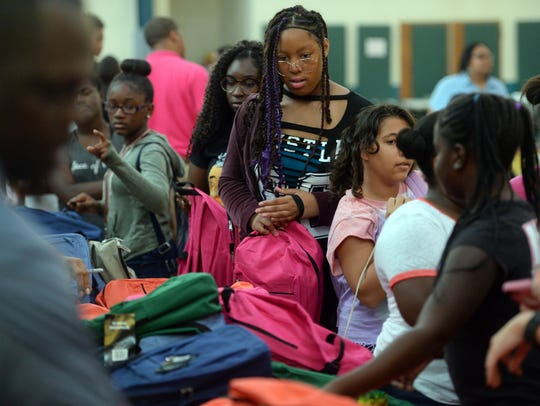 Nearly 200 backpacks were handed out to local students