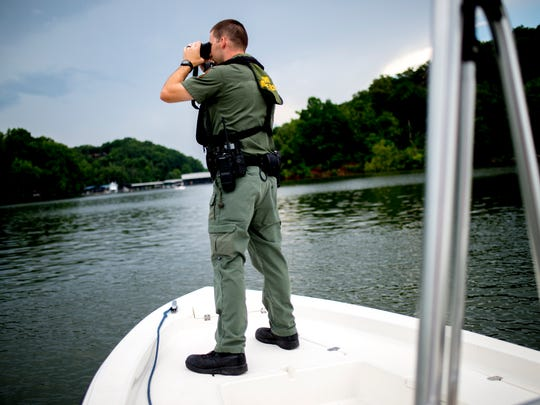 TWRA Officer Jeff Roberson patrols the waterways outside of Fort Loudoun Yacht Club in Knoxville, Tennessee on Saturday, July 7, 2018. TWRA increases its patrols of Tennessee waterways during the summer months to enforce boating regulations and boating safety.