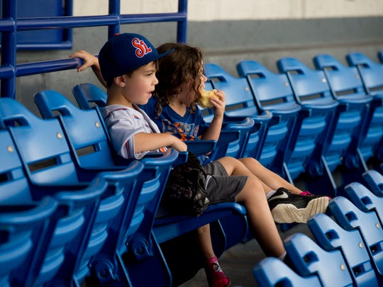 Siblings Liam Gamache (left), 6, and Cadence Gamache, 3, of Palm City, enjoy a St. Lucie Mets game Sunday, July 8 at First Data Field in Port St. Lucie. Although renovations to the New York Mets baseball complex have been delayed, all 7,000 seats in the stadium will eventually be replaced.