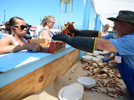 A lady gets her crabs at the 42nd Annual J. Millard