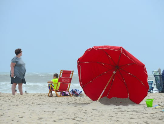This umbrella in the sand July 23, 2018, at Ocean City, Maryland, has been placed in the sand in the correct position against the wind.
