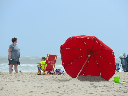 An umbrella has been placed in the sand in the correct position against the wind on the beach in Ocean City, Md. on Monday, July 23, 2018.