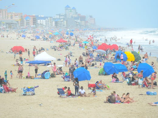 Umbrellas Line The Beach In Ocean City Md On Monday