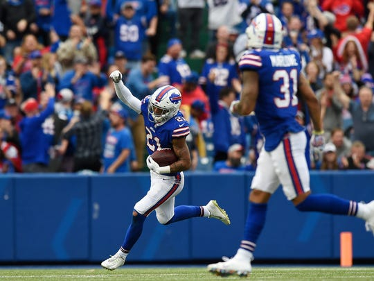 BUFFALO, NY - OCTOBER 07: Free safety Jordan Poyer #21 of the Buffalo Bills celebrates after recovering a fumble in the third quarter against the Tennessee Titans at New Era Field on October 7, 2018 in Buffalo, New York. (Photo by Patrick McDermott/Getty Images)