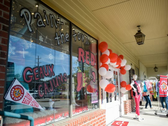 Local businesses decorate their workplaces in celebration of UL homecoming week during the Paint the Town Red competition in Lafayette, La., Tuesday, Oct. 28, 2014.  Paul Kieu, The Advertiser