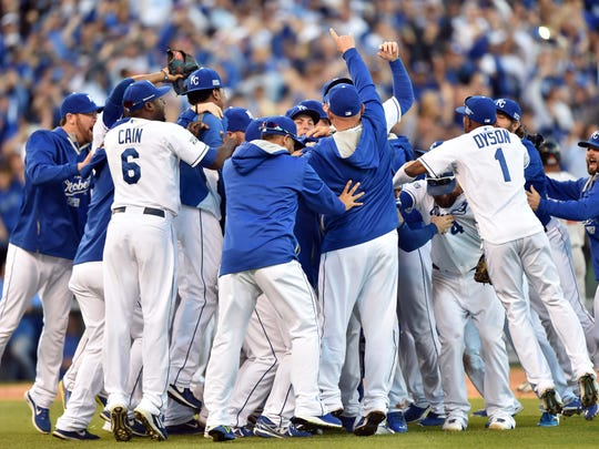 Kansas City Royals players celebrate on the field after defeating the Baltimore Orioles in Game 4 of the 2014 AL Championship Series at Kauffman Stadium. The Royals swept the Orioles to advance to the World Series.