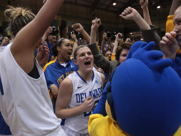 Guard Lauren Carra takes part in the victory with her teammates.