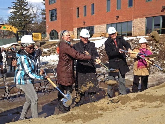 Ground is broken for Champlain College's new Center for Communications and Creative Media: (From left) first-year student Sabrina Parker, City Councilor Joan Shannon, President David Finney, trustee Bob Botjer and provost Robin Abramson.