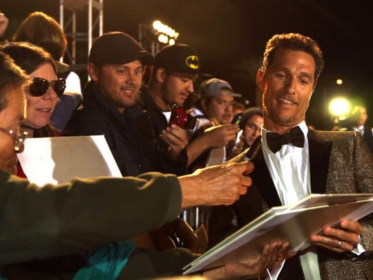 Actor Matthew McConaughey signs for fans during the red carpet arrivals at the 25th annual Palm Springs International Film Festival Gala Awards , Saturday, December 4, 2014 .