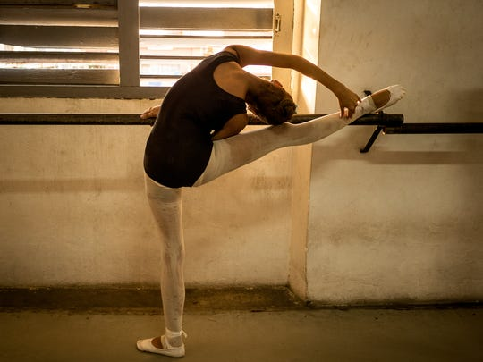 A student at the practice bar in National School of Ballet in Havana