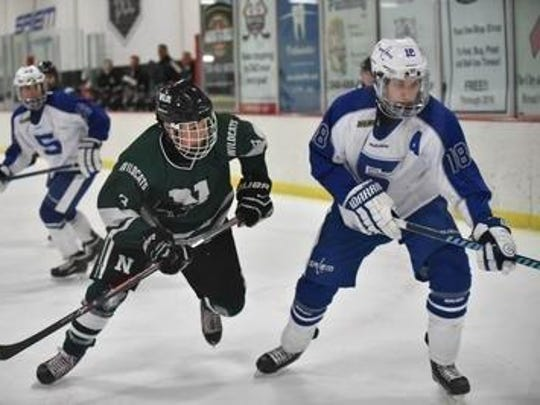 One of the newcomers for the Ocelots hockey team is forward Zach Goleniak (No. 18, right), shown from last season with Salem.
