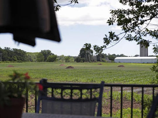 Farmland where construction of a manure pit is being proposed is shown from the back deck of Charity Schneider's Ledgeview house.