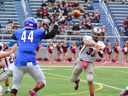 Michael DeSantis throws a pass against Metuchen last