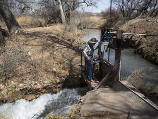 Frank Geminden (ditch boss) opens the Diamond S Ditch head gate, March 6, 2018, to clear out debris, Camp Verde, Arizona.