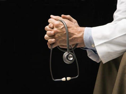 635513948763215050-holding-stethoscope