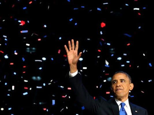 635502609480420108-obama-waving