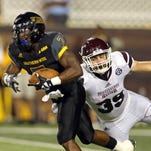 Southern Miss running back Justice Hayes is defended by Mississippi State linebacker Richie Brown in the second half of Saturday's game.