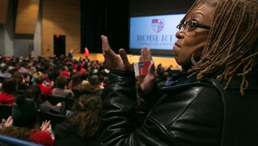 Debra Porcher listens during a campus-wide meeting to discuss a dorm theft where racial slurs were left at Roberts Wesleyan College in Rochester on Friday, February 5, 2016.