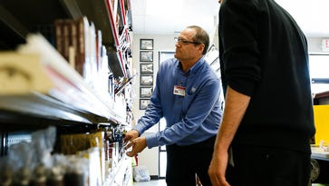 Tobacco Outlet Plus Store Leader Robert Nichols, left, stocks shelves with Jon Cole, 24 from Des Moines, a guest service co-worker at his store on Tuesday, August 23, 2016 in Des Moines. Tobacco Outlet Plus is owned by Kwik Trip who was named one of this years Top Workplaces.